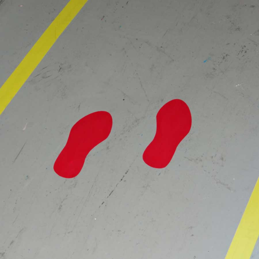 Huellas adhesivas para el marcaje de suelos en rojo, amarillo, azul y verde